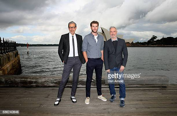 Jeff Goldblum Liam Hemsworth and Roland Emmerich pose during an 'Independence Day Resurgence' photo call outside the Park Hyatt on June 1 2016 in...