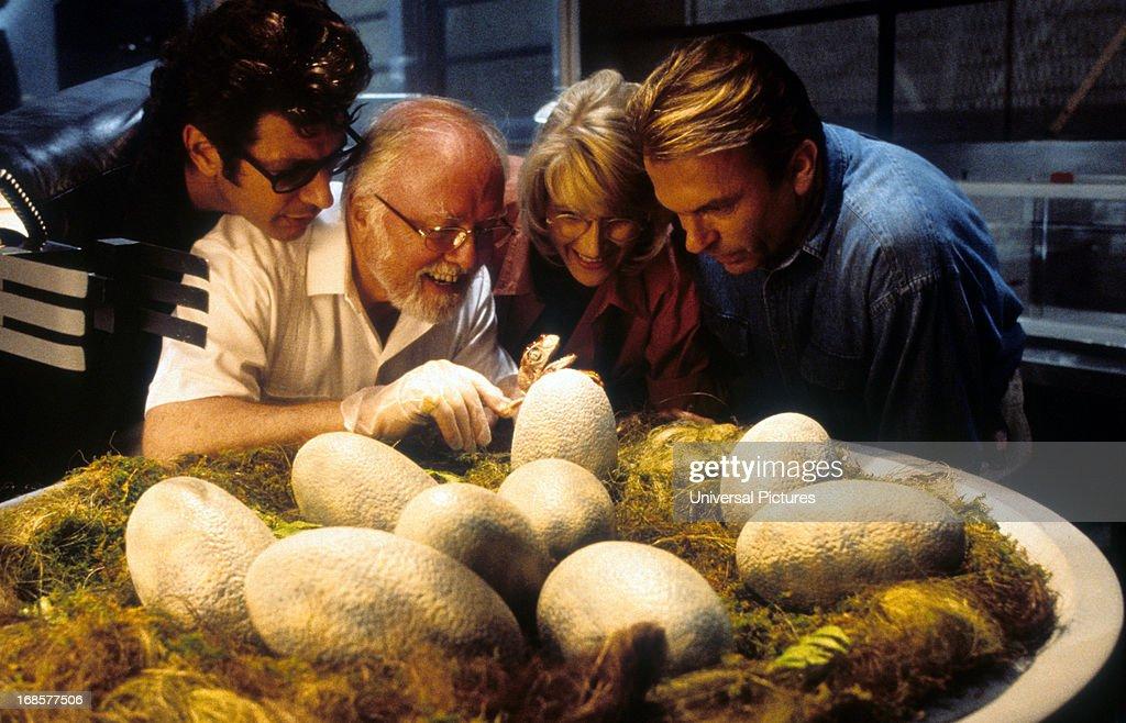 Jeff Goldblum, Richard Attenborough, Laura Dern and Sam Neill watch dinosaur eggs hatch in a scene from the film 'Jurassic Park', 1993.