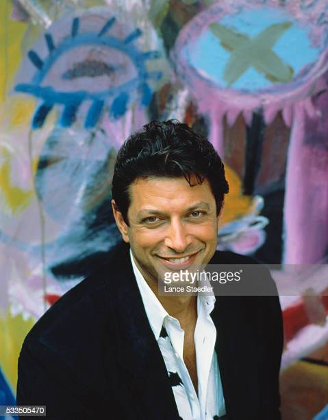 Jeff Goldblum Smiling in Front of Wall Painting