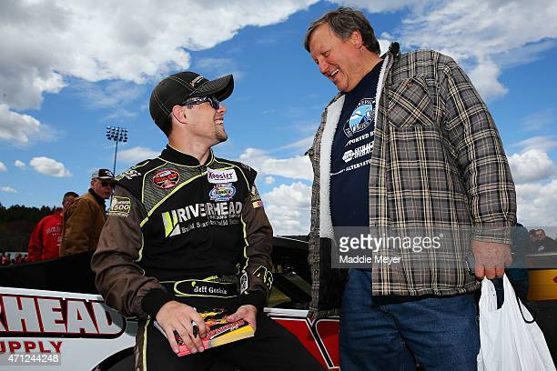 Jeff Goodale driver of the Riverhead Building Supply Chevrolet talks with a fan during the NAPA Auto Parts Pit Party before the start of the NAPA...