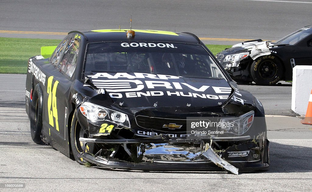 Jeff Gordan (24) returns the garage after crashing in a 12-car pile-up during test trials at Daytona International Speedway in Daytona Beach, Florida, Friday, January 11, 2013.