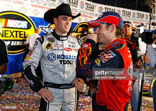 Jeff Gordon congratulates Jimmie Johnson after Johnson won the NASCAR Nextel Cup series Dickies 500 race at Texas Motor Speedway in Fort Worth Texas...