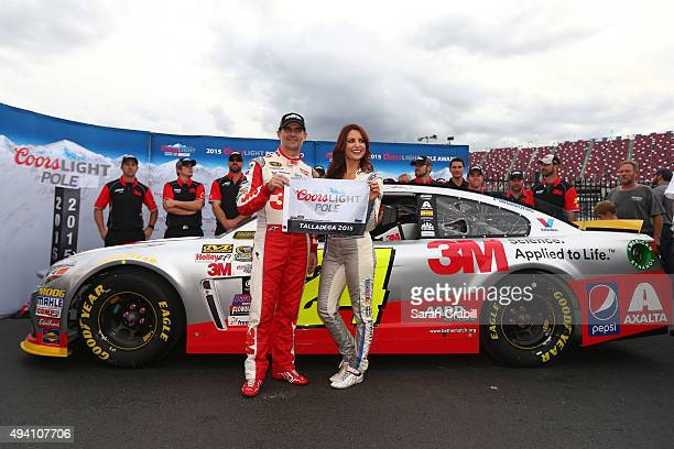 Jeff Gordon driver of the 3M Chevrolet poses with Miss Coors Light Amanda Mertz and the Coors Light Pole award after qualifying for the pole position...