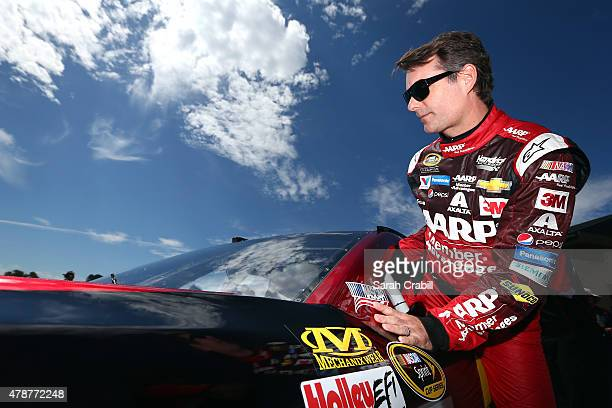 Jeff Gordon driver of the AARP Member Advantages Chevrolet climbs into his car during qualifying for the NASCAR Sprint Cup Series Toyota/Save Mart...