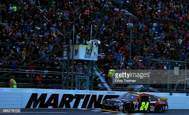 Jeff Gordon driver of the AARP Member Advantages Chevrolet crosses the finish line to win the NASCAR Sprint Cup Series Goody's Headache Relief Shot...