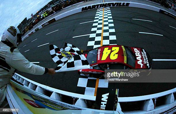 Jeff Gordon driver of the AARP Member Advantages Chevrolet takes the checkered flag to win the NASCAR Sprint Cup Series Goody's Headache Relief Shot...