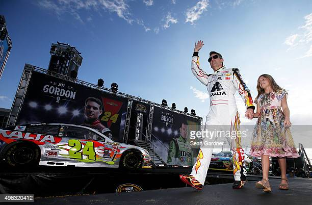 Jeff Gordon driver of the AXALTA Chevrolet and his daughter Ella Sofia walk on stage during prerace ceremonies for the NASCAR Sprint Cup Series Ford...