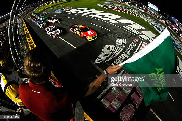 Jeff Gordon driver of the Axalta Chevrolet and Kevin Harvick driver of the Jimmy John's Chevrolet lead the field to the green flag to start the...