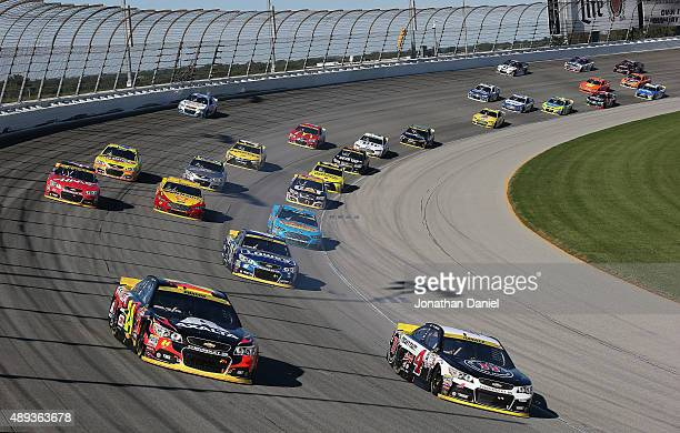 Jeff Gordon driver of the AXALTA Chevrolet and Kevin Harvick driver of the Jimmy John's / Budweiser Chevrolet lead a pack of cars during the NASCAR...
