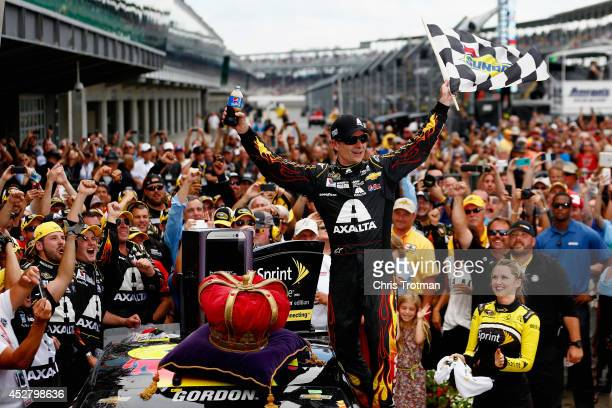 Jeff Gordon, driver of the Axalta Chevrolet, celebrates in Victory Lane after winning the NASCAR Sprint Cup Series Crown Royal Presents The John...