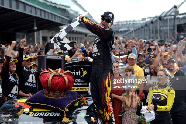 Jeff Gordon driver of the Axalta Chevrolet celebrates in Victory Lane after winning the NASCAR Sprint Cup Series Crown Royal Presents The John Wayne...