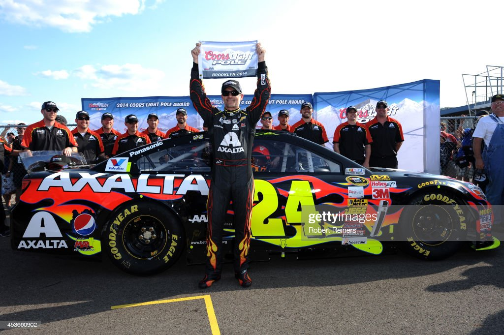 Jeff Gordon, driver of the #24 Axalta Chevrolet, celebrates with the Coors Light Pole Award after qualifying for the NASCAR Sprint Cup Series Pure Michigan 400 at Michigan International Speedway on August 15, 2014 in Brooklyn, Michigan.