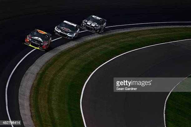 Jeff Gordon driver of the Axalta Chevrolet leads a pack of cars during the NASCAR Sprint Cup Series Crown Royal Presents The John Wayne Walding 400...