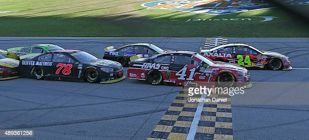 Jeff Gordon driver of the AXALTA Chevrolet leads a pack of cars during the NASCAR Sprint Cup Series myAFibRiskcom 400 at Chicagoland Speedway on...