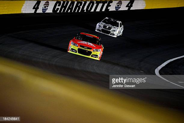 Jeff Gordon driver of the Axalta Chevrolet leads Jimmie Johnson driver of the Lowe's Dover White Chevrolet during the NASCAR Sprint Cup Series Bank...