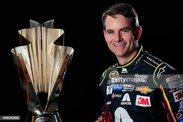 Jeff Gordon driver of the Axalta Chevrolet poses for a photo with the NASCAR Sprint Cup Trophy during the NASCAR Sprint Cup Championship 4 Media Day...