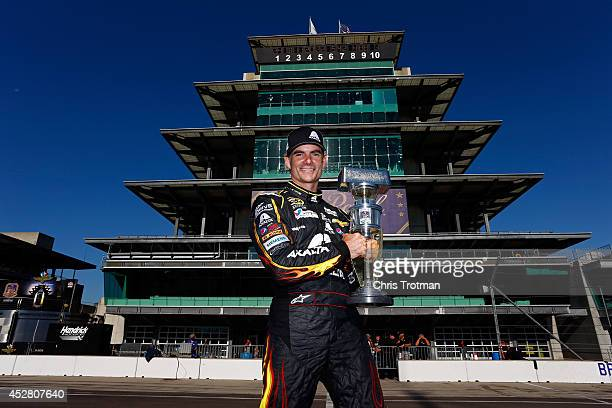 Jeff Gordon driver of the Axalta Chevrolet poses with the trophy after winning the NASCAR Sprint Cup Series Crown Royal Presents The John Wayne...