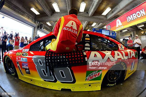 Jeff Gordon driver of the Axalta Chevrolet prepares to drive during practice for the NASCAR Sprint Cup Series Crown Royal presents the Combat Wounded...