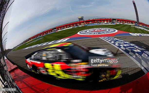 Jeff Gordon driver of the Axalta Chevrolet races during the NASCAR Sprint Cup Series Auto Club 400 at Auto Club Speedway on March 22 2015 in Fontana...