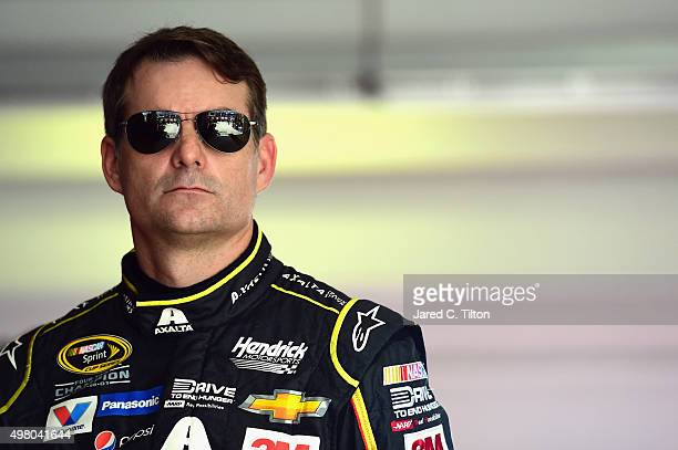 Jeff Gordon driver of the AXALTA Chevrolet stands in the garage area during practice for the NASCAR Sprint Cup Series Ford EcoBoost 400 at...