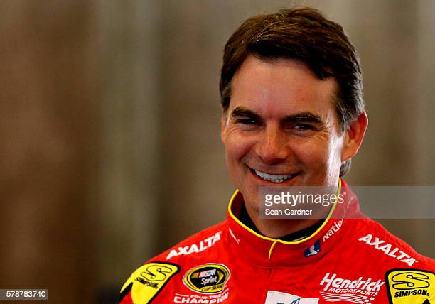 Jeff Gordon driver of the Axalta Chevrolet stands in the garage area during practice for the NASCAR Sprint Cup Series Crown Royal presents the Combat...
