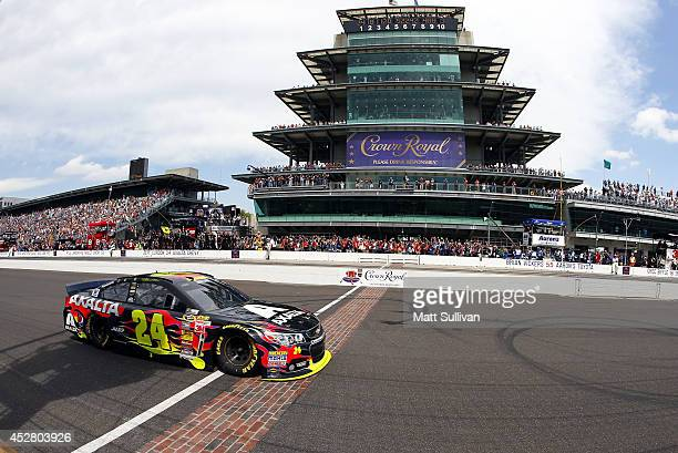Jeff Gordon driver of the Axalta Chevrolet takes the checkered flag to win the NASCAR Sprint Cup Series Crown Royal Presents The John Wayne Walding...