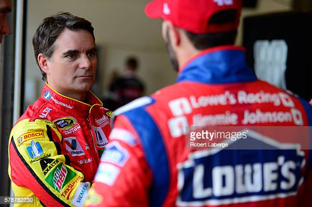 Jeff Gordon driver of the Axalta Chevrolet talks to teammate Jimmie Johnson driver of the Lowe's Red Vest Chevrolet during practice for the NASCAR...