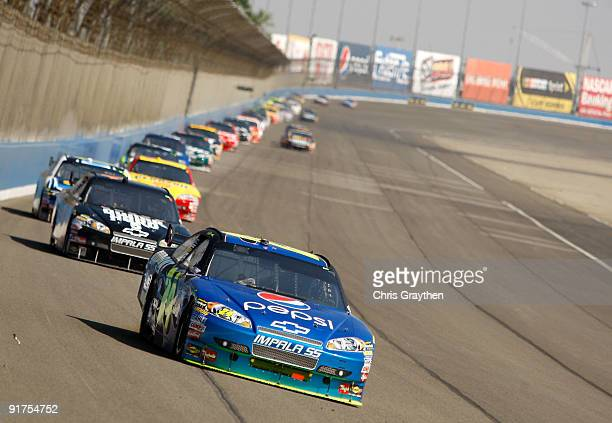 Jeff Gordon driver of the DePont/Pepsi Chevrolet leads a line of cars during the NASCAR Sprint Cup Series Pepsi 500 at Auto Club Speedway on October...