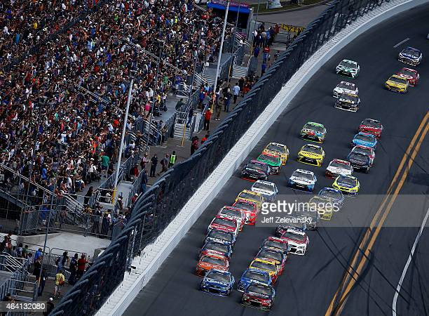 Jeff Gordon driver of the Drive To End Hunger Chevrolet and Jimmie Johnson driver of the Lowe's Chevrolet lead the field during the NASCAR Sprint Cup...