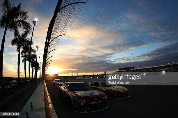 Jeff Gordon driver of the Drive To End Hunger Chevrolet and Joey Logano driver of the ShellPennzoil Ford race during the NASCAR Sprint Cup Series...