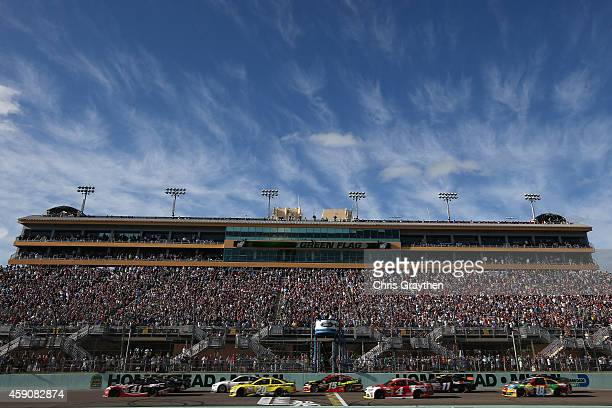 Jeff Gordon driver of the Drive To End Hunger Chevrolet and Kurt Busch driver of the Haas Automation Chevrolet lead the field on the first lap of the...