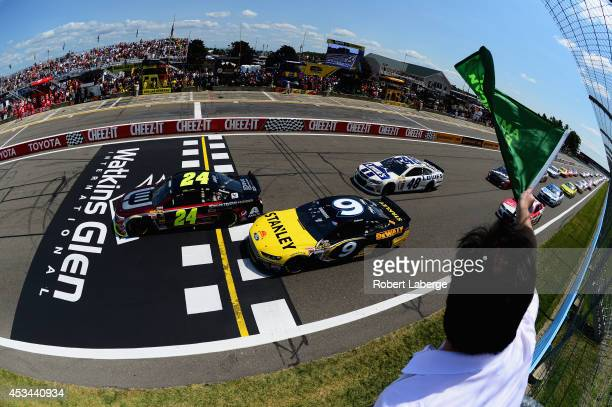 Jeff Gordon, driver of the Drive to End Hunger Chevrolet, and Marcos Ambrose, driver of the Stanley Ford, lead the field to the green flag for the...