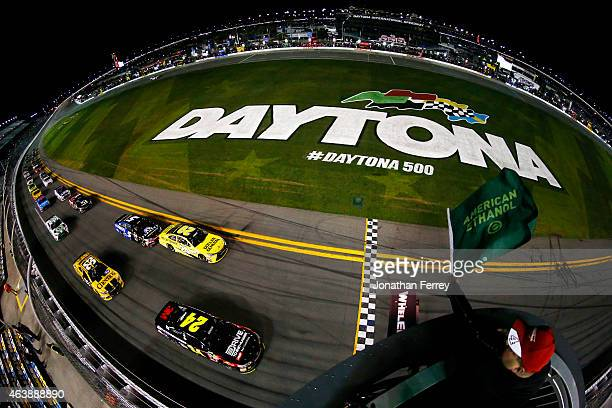 Jeff Gordon driver of the Drive To End Hunger Chevrolet and Matt Kenseth driver of the Dollar General Toyota lead the field to the green flag for the...