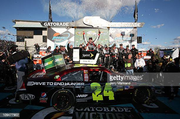 Jeff Gordon driver of the Drive to End Hunger Chevrolet celebrates in victory lane after winning the NASCAR Sprint Cup Series Subway Fresh Fit 500 at...