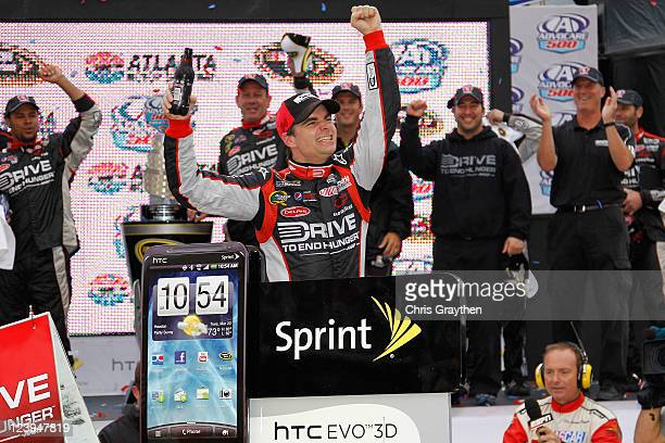 Jeff Gordon driver of the Drive to End Hunger Chevrolet celebrates in victory lane after winning the NASCAR Sprint Cup Series AdvoCare 500 at Atlanta...