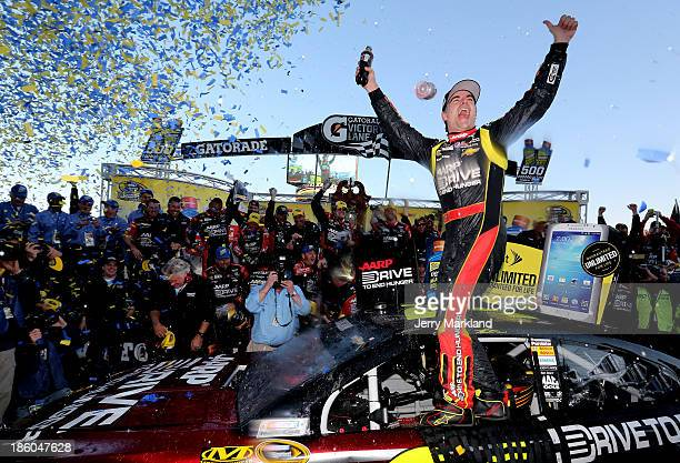 Jeff Gordon driver of the Drive To End Hunger Chevrolet celebrates in victory lane after winning the NASCAR Sprint Cup Series Goody's Headache Relief...