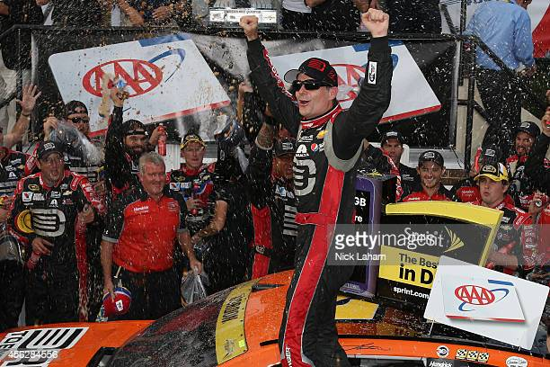 Jeff Gordon driver of the Drive To End Hunger Chevrolet celebrates in Victory Lane after winning the NASCAR Sprint Cup Series AAA 400 at Dover...