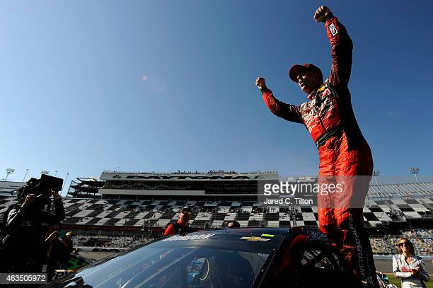 Jeff Gordon driver of the Drive To End Hunger Chevrolet celebrates after qualifying for pole position for the 57th Annual Daytona 500 at Daytona...