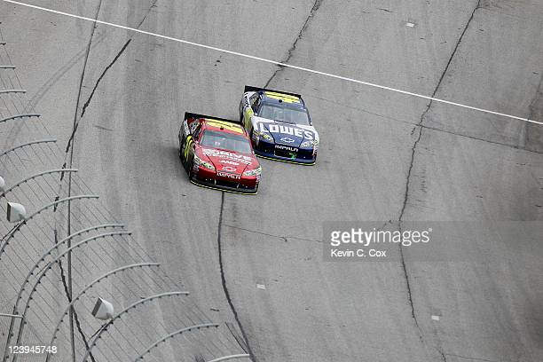 Jeff Gordon, driver of the Drive to End Hunger Chevrolet, races Jimmie Johnson, driver of the Lowe's Chevrolet, during the NASCAR Sprint Cup Series...