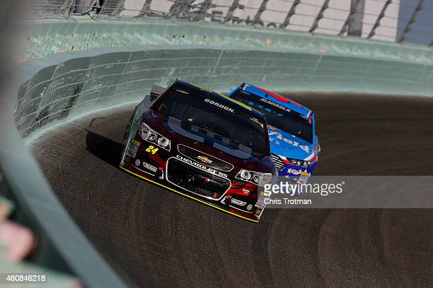 Jeff Gordon, driver of the Drive To End Hunger Chevrolet, races with David Ragan, driver of the The Pete Store Ford, during the NASCAR Sprint Cup...