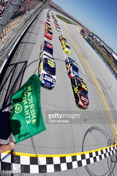 Jeff Gordon driver of the Drive to End Hunger/AARP Chevrolet and Jimmie Johnson driver of the Lowe's Chevrolet lead the field to the green flag to...