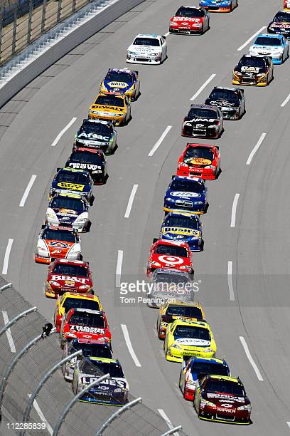 Jeff Gordon driver of the Drive to End Hunger/AARP Chevrolet and Jimmie Johnson driver of the Lowe's Chevrolet lead the field during the NASCAR...