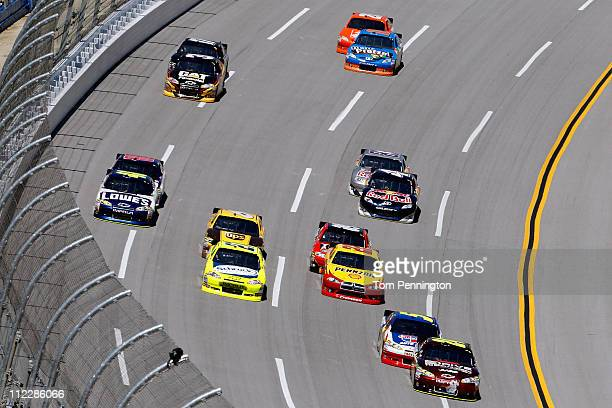 Jeff Gordon driver of the Drive to End Hunger/AARP Chevrolet leads the field during the NASCAR Sprint Cup Series Aaron's 499 at Talladega...