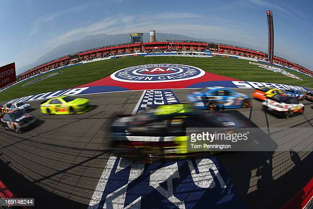 Jeff Gordon driver of the Drive To End/DuPont Finishes/Pepsi Max Chevrolet drives during the NASCAR Sprint Cup Series Auto Club 400 at Auto Club...
