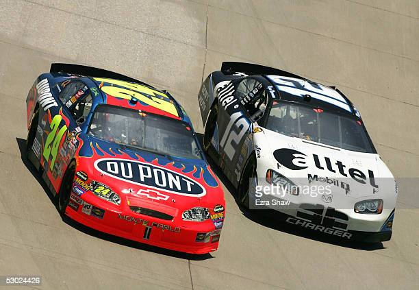 Jeff Gordon driver of the DuPont Chevrolet car and Ryan Newman driver of the alltel Dodge car round turn 1 during the NASCAR Nextel Cup MBNA...