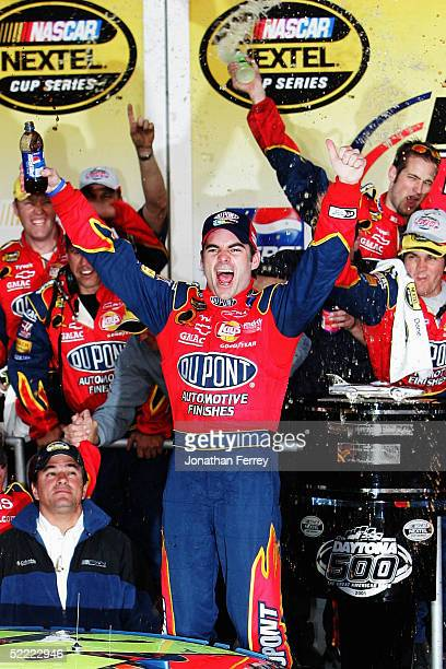 Jeff Gordon driver of the Dupont Chevrolet celebrates his victory during the NASCAR Nextel Cup Daytona 500 on February 20 2005 at Daytona...