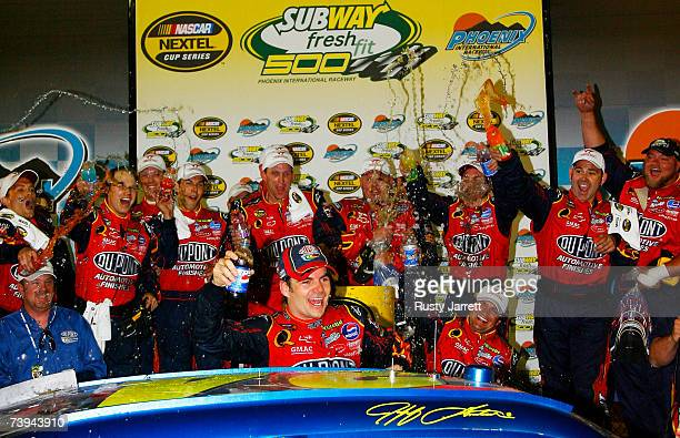 Jeff Gordon, driver of the DuPont Chevrolet, celebrates in victory lane with his team after winning the NASCAR Nextel Cup Series Subway Fresh Fit 500...