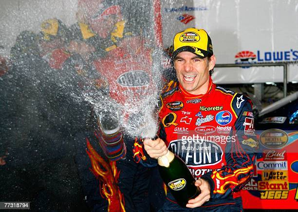 Jeff Gordon, driver of the DuPont Chevrolet, celebrates in victory lane after winning the NASCAR Nextel Cup Series Bank of America 500 at Lowe's...
