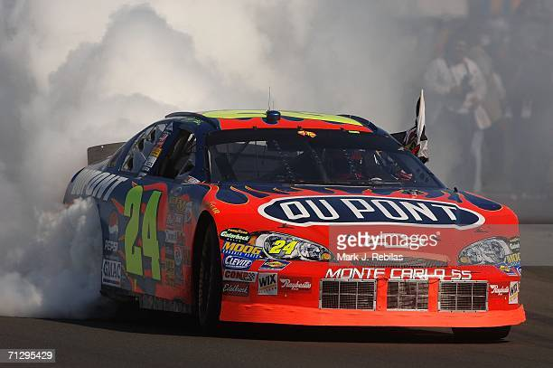 Jeff Gordon, driver of the DuPont Chevrolet, celebrates winning with a burn out after the NASCAR Nextel Cup Series Dodge/Save Mart 350 at the...