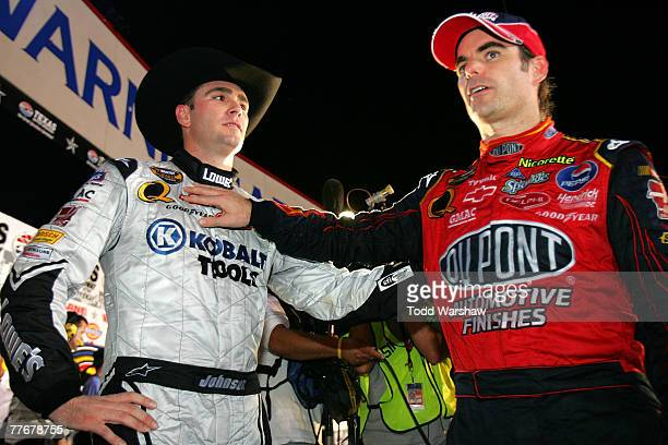 Jeff Gordon driver of the DuPont Chevrolet congratulates teammate Jimmie Johnson driver of the Lowe's/Kobalt Chevrolet after winning the NASCAR...